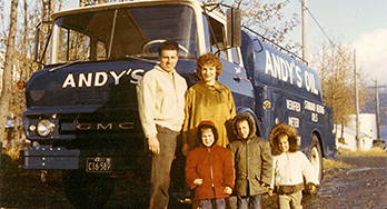 This is a family of people including a mother and father and a few children standing in front of a bus. This gives the feeling of family oriented business and trustworthy petroleum products. Petro Marine started as Andy's and services all types fuel needs